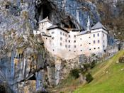 "Built within a cave in the middle of a towering cliff, <a href=""https://www.cntraveler.com/gallery/best-places-to-visit-in-slovenia?mbid=synd_yahoo_rss"" rel=""nofollow noopener"" target=""_blank"" data-ylk=""slk:Predjama"" class=""link rapid-noclick-resp"">Predjama</a>, which dates back to 1274, is imposing by most standards. Add in local legend and you'll be hard pressed <em>not</em> to get spooked: Once the residence of knight Erazem Lueger, Predjama has hidden passageways and was reputedly a site of torture and treachery. Lueger was betrayed by his servants and killed in the castle, and is said to still haunt it today."