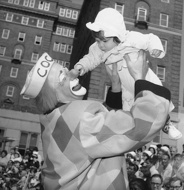 <p>Finger tip on nose of Coco, the clown, one-year old Edgar (last name not available), a patient at Bellevue Hospital in New York, gets into the swing of things as members of the Ringling Brothers Barnum and Bailey Circus entertain the youngsters on April 29, 1956. (AP Photo) </p>