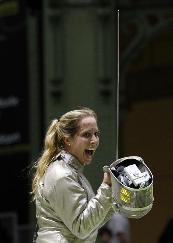 FILE - In this Nov. 6, 2010, file photo, Mariel Zagunis, of the U.S., reacts as she defeats Ukraine's Olga Kharlan in the women's single sabre final at the fencing World Championships in Paris. Zagunis is seeking her third consecutive Olympic gold medal in saber, and the men's team wants to improve on its silver finish in Beijing.(AP Photo/Christophe Ena, File)