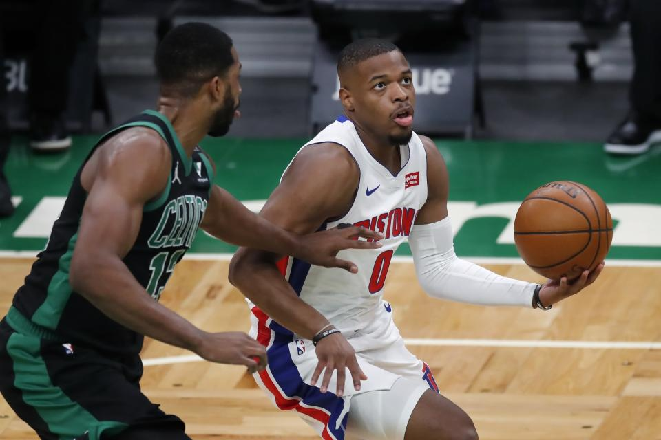 Detroit Pistons' Dennis Smith Jr. (0) drives for the basket past Boston Celtics' Tristan Thompson (13) during the first half of an NBA basketball game Friday, Feb. 12, 2021, in Boston. (AP Photo/Michael Dwyer)