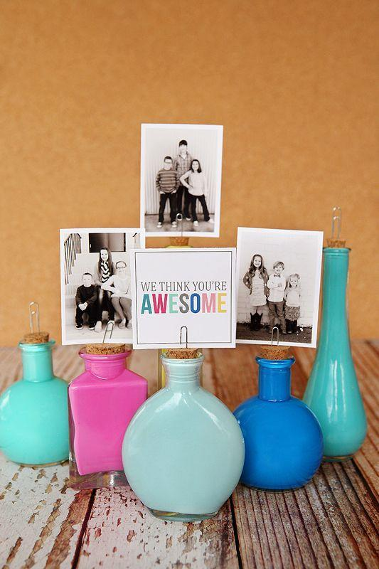 "<p>With the help of bright-hued craft paint, dollar store jars go from plain to fancy. And the elevated photo frame adds a sentimental touch. </p><p><em><a href=""http://eighteen25.blogspot.com/2013/05/painted-photo-bottles.html"" rel=""nofollow noopener"" target=""_blank"" data-ylk=""slk:Get the tutorial at Eighteen25 »"" class=""link rapid-noclick-resp"">Get the tutorial at Eighteen25 »</a></em> </p>"
