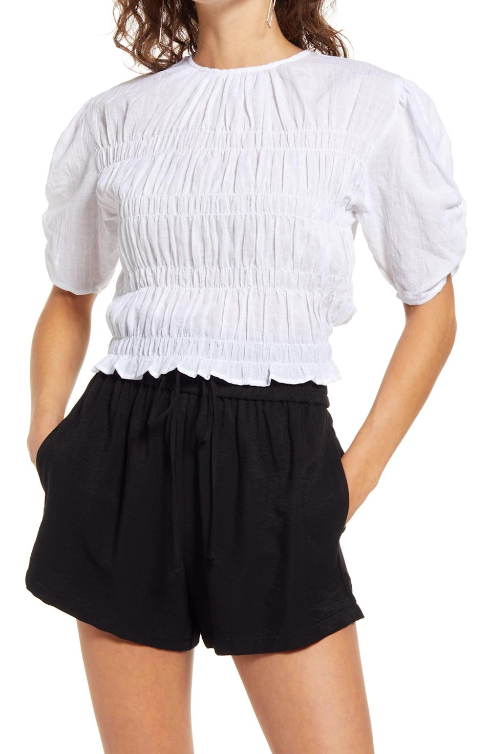 <p>This <span>Open Edit Smocked Short Sleeve Top</span> ($55) will add a dose of refined style to any look.</p>