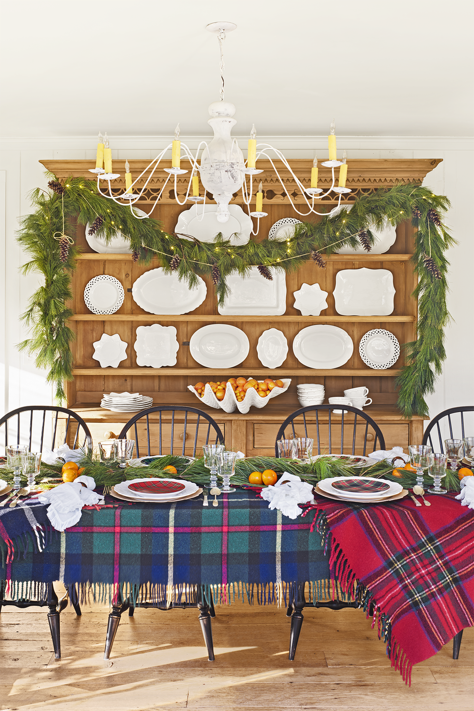 "<p><a href=""https://www.countryliving.com/home-design/house-tours/g4928/christmas-in-connecticut/"" rel=""nofollow noopener"" target=""_blank"" data-ylk=""slk:This Cape Cod homeowner"" class=""link rapid-noclick-resp"">This Cape Cod homeowner</a> used complementing tartan patterns to dress up her dining table for the holidays. In addition to plaid blankets, layered here as tablecloths, you can also mix in more pattern with dishware and napkins. </p><p><a class=""link rapid-noclick-resp"" href=""https://go.redirectingat.com?id=74968X1596630&url=https%3A%2F%2Fwww.wayfair.com%2Fbed-bath%2Fsb1%2Fplaid-blankets-throws-c415002-a18804%7E75894.html&sref=https%3A%2F%2Fwww.countryliving.com%2Fdiy-crafts%2Fg644%2Fchristmas-tables-1208%2F"" rel=""nofollow noopener"" target=""_blank"" data-ylk=""slk:SHOP PLAID THROWS"">SHOP PLAID THROWS</a><br></p>"