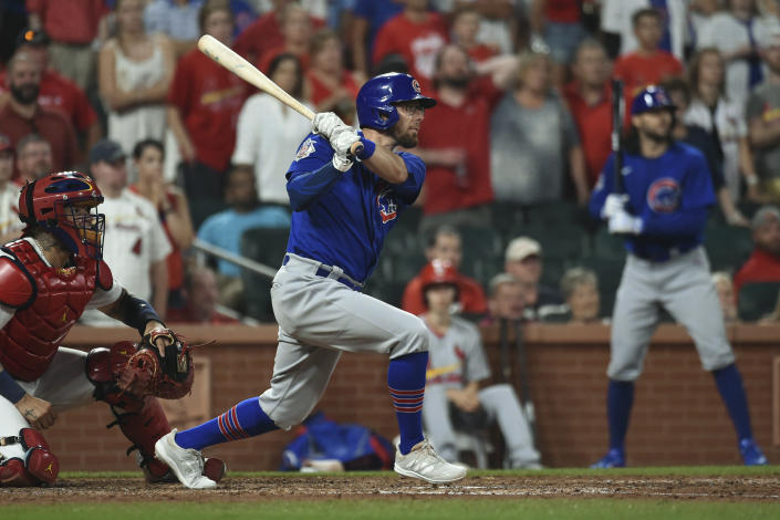 Chicago Cubs' Eric Sogard watches his RBI double during the ninth inning of the team's baseball game against the St. Louis Cardinals on Wednesday, July 21, 2021, in St. Louis. (AP Photo/Joe Puetz)