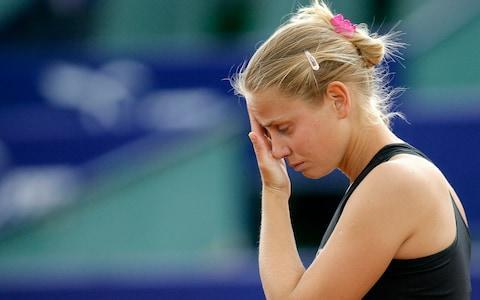 <span>Jelena Dokic reacts during a match in 2009 </span> <span>Credit: AP </span>