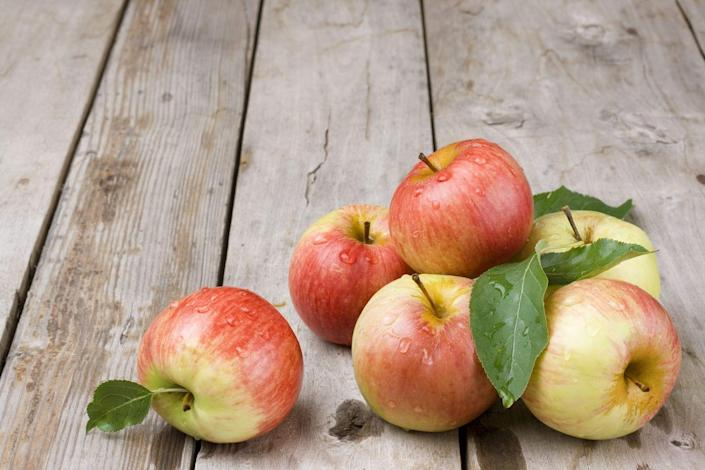 """<p>When you have a craving for something sweet, reach for an apple. """"One large apple has 5 grams of fiber and 14% of your daily vitamin C—important for your immunity and for keeping weight off,"""" writes <a href=""""https://www.doctoroz.com/"""" rel=""""nofollow noopener"""" target=""""_blank"""" data-ylk=""""slk:Mehmet Oz"""" class=""""link rapid-noclick-resp"""">Mehmet Oz</a>, M.D., in his book <a href=""""https://www.amazon.com/Food-Can-Fix-Superfood-Healthy/dp/1501158163/?tag=syn-yahoo-20&ascsubtag=%5Bartid%7C10050.g.35715141%5Bsrc%7Cyahoo-us"""" rel=""""nofollow noopener"""" target=""""_blank"""" data-ylk=""""slk:Food Can Fix It"""" class=""""link rapid-noclick-resp""""><em>Food Can Fix It</em></a>. To start your day right, try this quick and easy <a href=""""https://www.prevention.com/food-nutrition/recipes/a20522990/apple-cinnamon-yogurt/"""" rel=""""nofollow noopener"""" target=""""_blank"""" data-ylk=""""slk:Apple-Cinnamon Yogurt"""" class=""""link rapid-noclick-resp"""">Apple-Cinnamon Yogurt</a> recipe.</p>"""