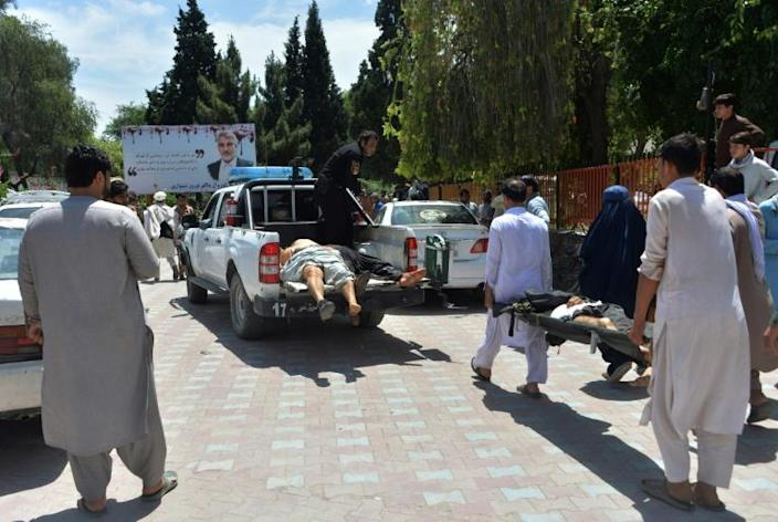 Wounded mourners are taken to hospital after a suicide bomb attack on a funeral in eastern Afghanistan (AFP Photo/NOORULLAH SHIRZADA)