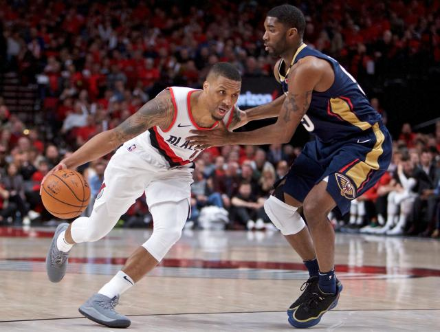 "<a class=""link rapid-noclick-resp"" href=""/nba/players/5012/"" data-ylk=""slk:Damian Lillard"">Damian Lillard</a> skipped Monday's NBA Awards show and instead hung out with some <a class=""link rapid-noclick-resp"" href=""/nba/teams/por"" data-ylk=""slk:Blazers"">Blazers</a> fans in Portland handing out shoes and autographs. (AP)"