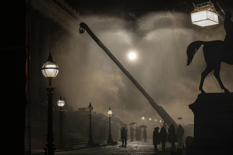 A fight scene breaks out as protesters clash with police, on the steps of St George's Hall, as artificial rain falls. Peaky Blinders start filming in Liverpool, at St George's Hall, as season 6 gets underway, pictured in Liverpool city centre, March 4 2021. (SWNS)