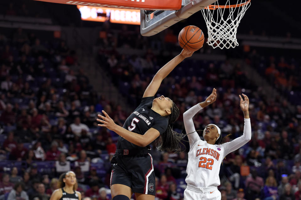 South Carolina's Victaria Saxton (5) stretches for the ball while defended by Clemson's Danae McNeal (22) during the second half of an NCAA college basketball game Sunday, Nov. 24, 2019, in Clemson, S.C. (AP Photo/Richard Shiro)