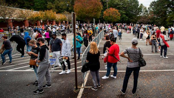 PHOTO: Hundreds of people wait in line for early voting in Marietta, Georgia, Oct. 12, 2020. (Ron Harris/AP)