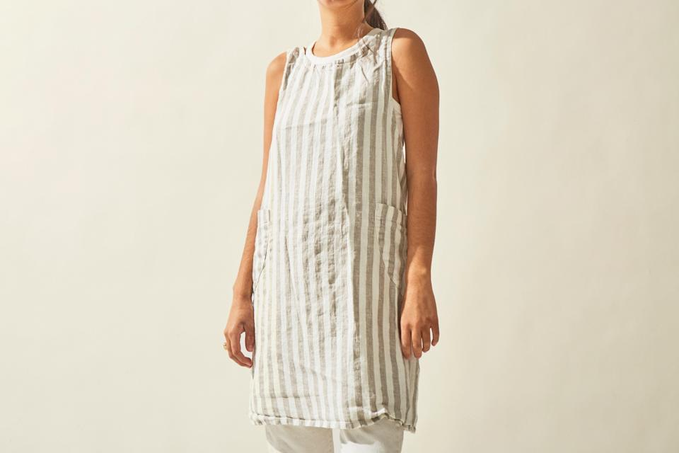 """This stylish linen apron combines classic French and Japanese styles for the perfect balance of form and function. Its full A-line design makes it both flattering and easy to wear. $115, The Good Gray. <a href=""""https://www.goodgray.com/new-products/mkxc7ze12da5v1hqdhq4ydfcrfgdlc"""" rel=""""nofollow noopener"""" target=""""_blank"""" data-ylk=""""slk:Get it now!"""" class=""""link rapid-noclick-resp"""">Get it now!</a>"""