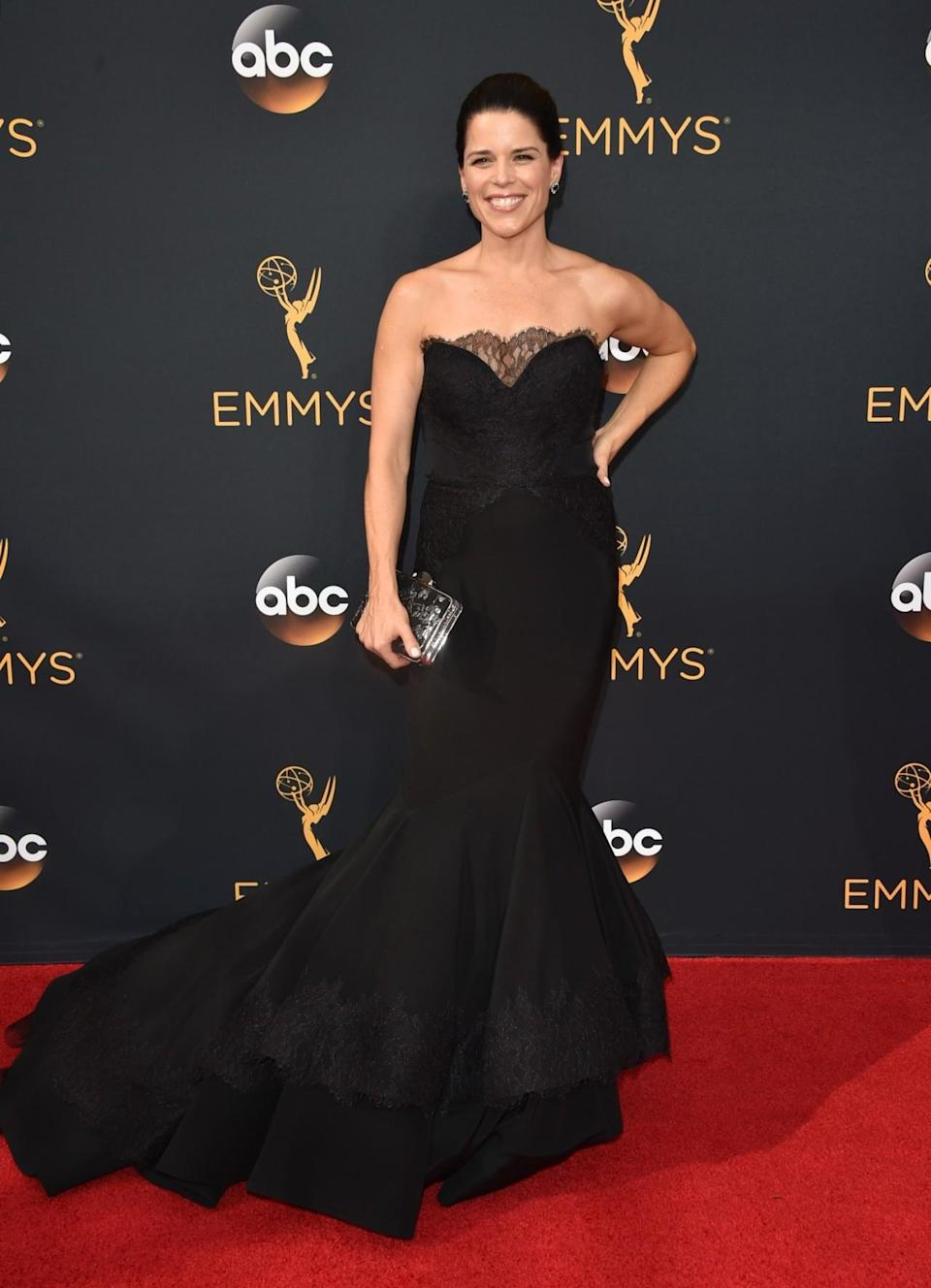 """<p>""""This beauty @nevecampbell doesn't age and it was a pleasure creating this custom lace appliqué gown for her,"""" Siriano wrote on Instagram. <em>(Photo: Getty Images)</em></p>"""