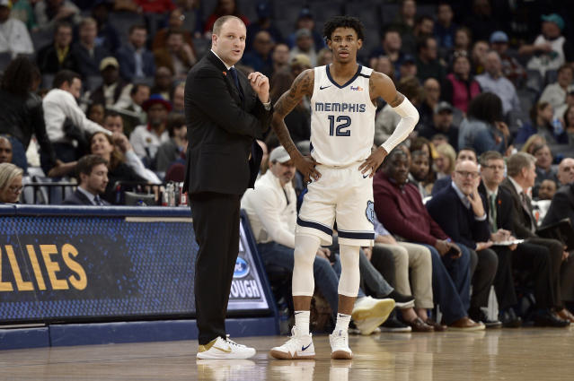 Memphis Grizzlies head coach Taylor Jenkins talks with guard Ja Morant (12) in the second half of an NBA basketball game against the Denver Nuggets Tuesday, Jan. 28, 2020, in Memphis, Tenn. (AP Photo/Brandon Dill)