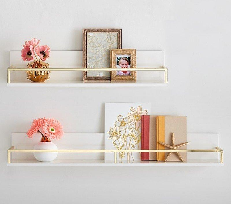 "<p>Adding a set of floating shelves is a sleek, modern way to introduce over-the-toilet storage into your space. But to prevent bottles and products from accidentally falling, look for shelves with a convenient rail. We spotted these white-and-gold shelves in the kids' section, but they look elegant enough for a grownup bathroom, too. </p> <p><strong>To buy: </strong>$89, <a href=""http://pbkids.7eer.net/c/249354/267850/4333?subId1=RS%2C5WaystoMaximizeYourBathroom%25E2%2580%2599sOver-the-ToiletStorage%2Ckholdefehr1271%2CORG%2CIMA%2C670523%2C201908%2CI&u=https%3A%2F%2Fwww.potterybarnkids.com%2Fproducts%2Fpolished-shelving%2F%3FcatalogId%3D10%26sku%3D2450239"" target=""_blank"">potterybarnkids.com</a>. </p>"