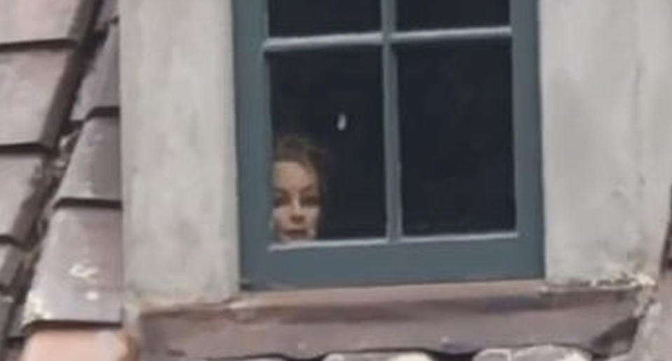 A mannequin head is seen in the window of a home in Carmel, California.