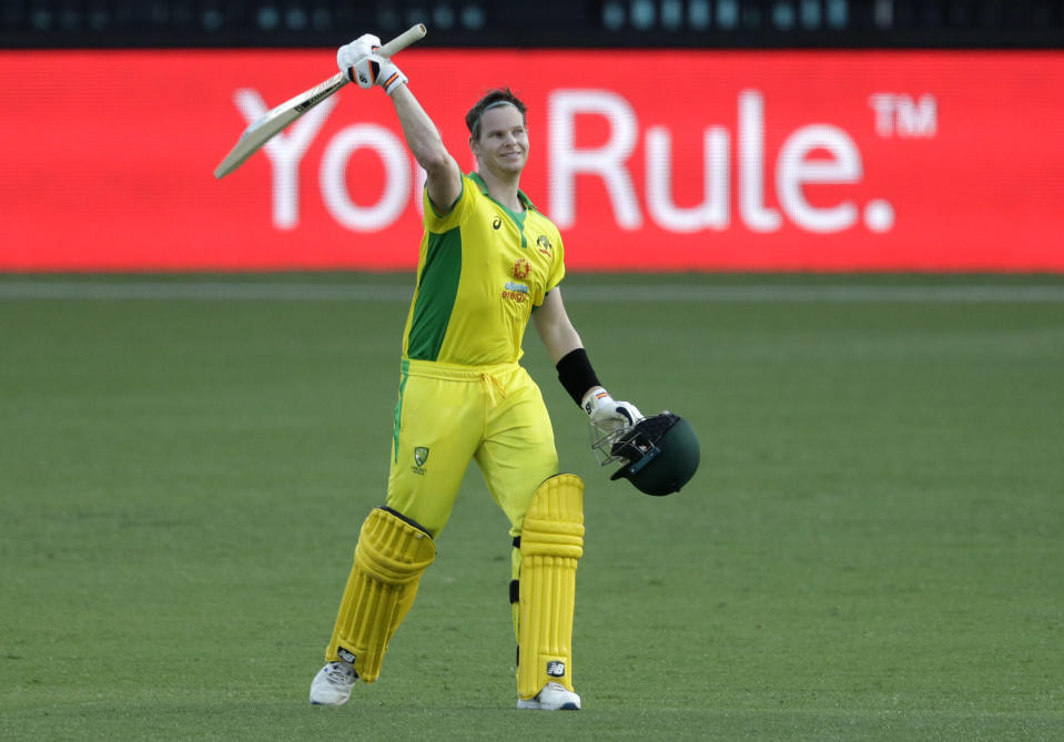 Australia's Steve Smith celebrates after scoring a century during the one day international cricket match between India and Australia at the Sydney Cricket Ground in Sydney, Australia, Friday, Nov. 27, 2020. (AP Photo/Rick Rycroft)