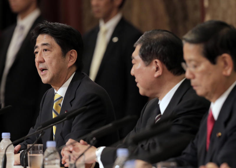 "In this Sept. 15, 2012 photo, Japan's leading opposition Liberal Democratic Party presidential candidate Shinzo Abe, left, as his rivals, Shigeru Ishiba, center, and Nobutaka Machimura, listen to him during a debate at the Japan National Press Club in Tokyo. Former Prime Minister Abe blasted China at a press conference Wednesday, Sept. 18, 2012, after anti-Japanese riots flared across China. He says that if Beijing can't protect Japanese living in China it ""should not enjoy membership in the international society."" (AP Photo/Itsuo Inouye)"