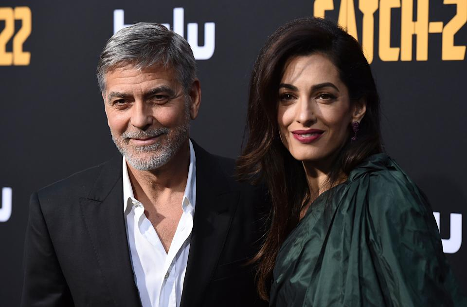"""George Clooney and Amal Clooney arrive at the Los Angeles premiere of """"Catch-22"""" at TCL Chinese Theatre on Tue., May 7, 2019. (Photo by Jordan Strauss/Invision/AP)"""