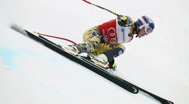 """FILE = In this Feb. 18, 2012 file picture Lindsey Vonn, of the United States, competes during a women's World Cup downhill on the Sochi Olympics course, in Krasnaya Polyana, near Sochi, Russia . The United States ski team says it hasn't had any """"formal discussion"""" yet about the possibility of Lindsey Vonn entering a men's World Cup downhill next month. Vonn, the women's Olympic downhill champion, has written the International Ski Federation to ask whether she can challenge the men on Nov. 24 in Lake Louise, Alberta. Vonn has earned nine of her 26 World Cup downhill victories at the Canadian track, which stages women's races the following weekend. The U.S. Ski and Snowboard Association says """"we clearly have great respect for Lindsey, her accomplishments in the sport and her desire to seek this new challenge. But we have not had any formal discussion yet between Lindsey and FIS."""" FIS secretary general Sarah Lewis tells The Associated Press the governing body can't make a decision on the matter until the team submits a formal request. (AP Photo/Alessandro Trovati,File)"""