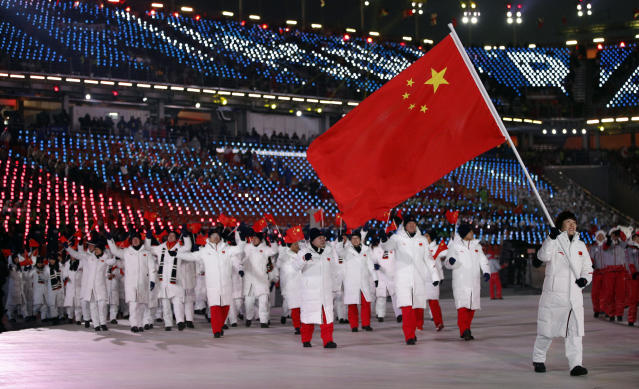 <p>Zhou Yang carries the flag of China during the opening ceremony of the 2018 Winter Olympics in Pyeongchang, South Korea, Friday, Feb. 9, 2018. (AP Photo/Jae C. Hong) </p>