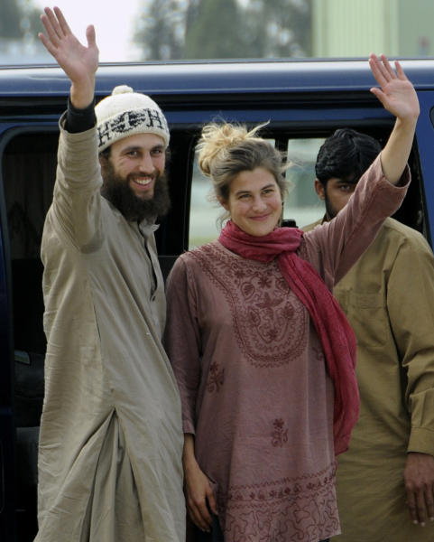 Swiss couple David Och and Daniela Widmer wave upon their arrival at Qasim military base in Rawalpindi, Pakistan on Thursday, March 15, 2012. A Swiss couple held captive for nearly a year by the Taliban in Pakistan turned up at an army post close to the Afghan border on Thursday, claiming to have escaped from their captors, the Pakistani army said. They were swiftly flown to safety by the military. (AP Photo/B.K. Bangash)