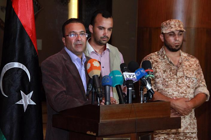 Ahmed Hadia, spokesman for the Misrata Central Shield Brigade (L), speaks during a press conference in Tripoli on August 17, 2014 (AFP Photo/)
