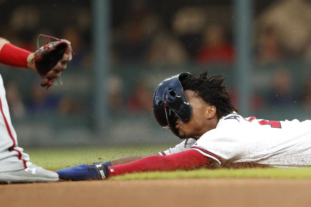 Atlanta Braves' Ronald Acuna Jr. beats the throw as he steals second base in the first inning of a baseball game Saturday, July 20, 2019, in Atlanta. (AP Photo/John Bazemore)