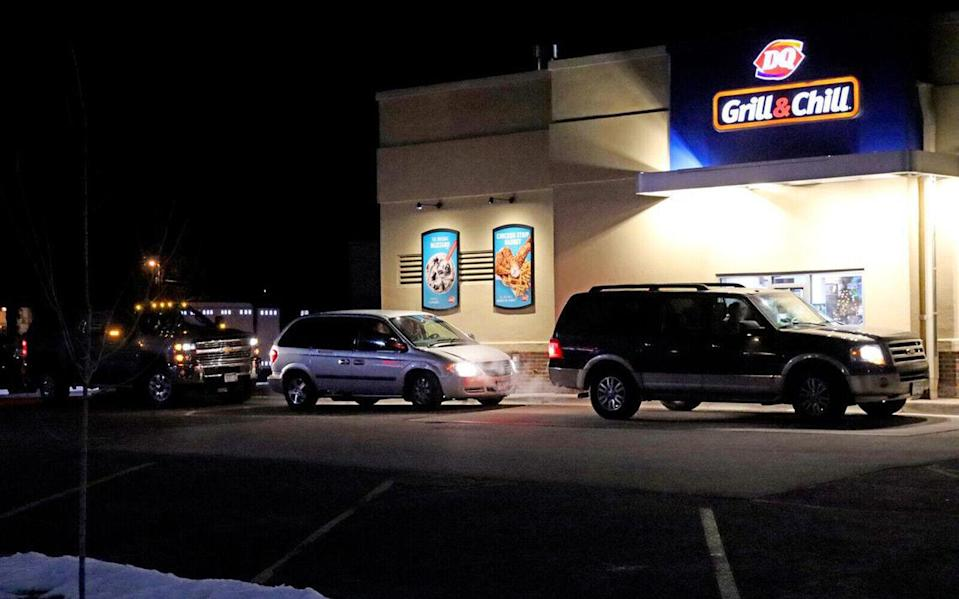The cars lined up outside the Dairy Queen.