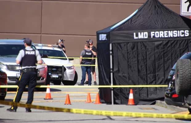 A forensics tent covers the spot where gang associate Todd Gouwenberg was shot and killed outside the Langley Sportsplex on Wednesday. (Shane MacKichan/CBC - image credit)