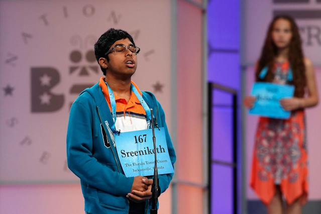 <p>Sreeniketh Vogoti, 14, of Saint Johns, Fla., left, thinks about how to spell his word, as Rebekah Zeigler, 12, of Polo, Ill., waits her turn, during the 90th Scripps National Spelling Bee in Oxon Hill, Md., Wednesday, May 31, 2017. (AP Photo/Jacquelyn Martin) </p>