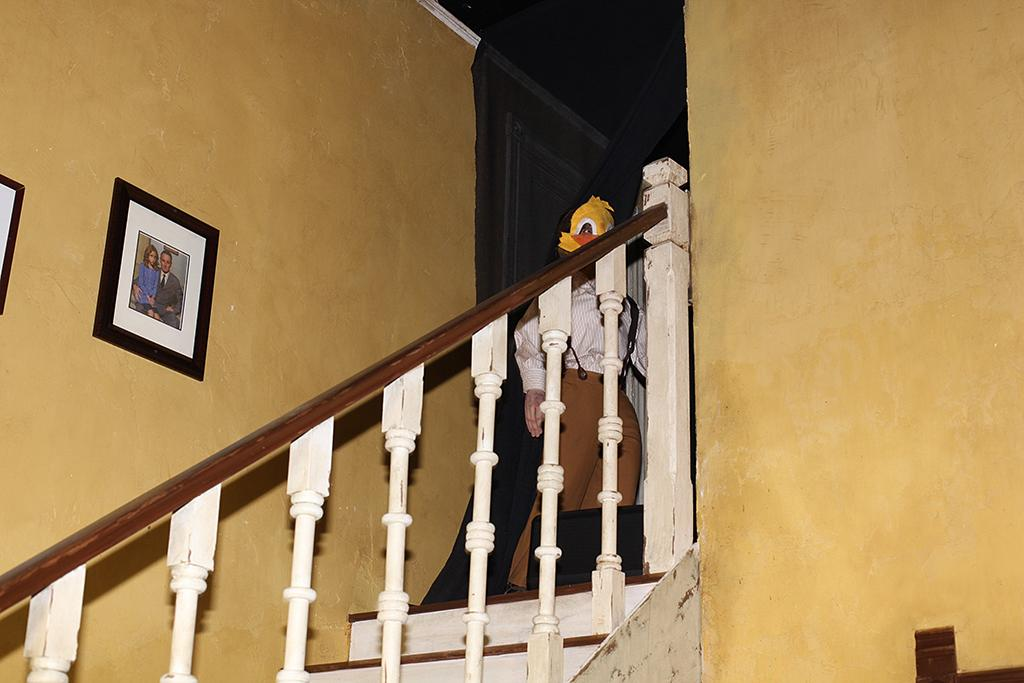 <p>Upon entering the <em>Insidious 4</em> house, guests are greeted by this eerie duck-faced boy ghost at the top of the stairs. (Photo: Camilo Urdaneta/Yahoo) </p>