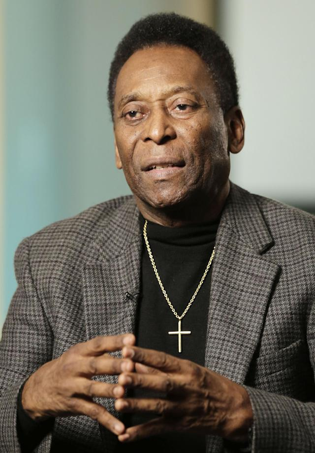 In this Wednesday, April 2, 2014 photo, Edson Arantes do Nascimento, better known as Pele, is interviewed at The Associated Press in New York. The retired Brazilian soccer star played on three winning World Cup teams in 1958, 1962, and 1970. In a little more than two months, the World Cup will be played in Brazil for the first time since 1950. (AP Photo/Mark Lennihan)