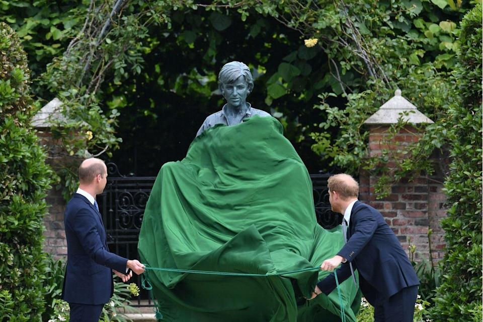 <p>Prince William and Prince Harry unveil a statue of Princess Diana together. </p>