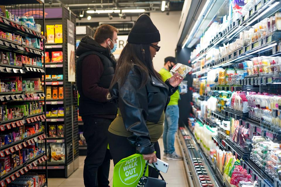 Customers shop for goods inside Amazon's new Amazon Fresh store in Ealing, west London