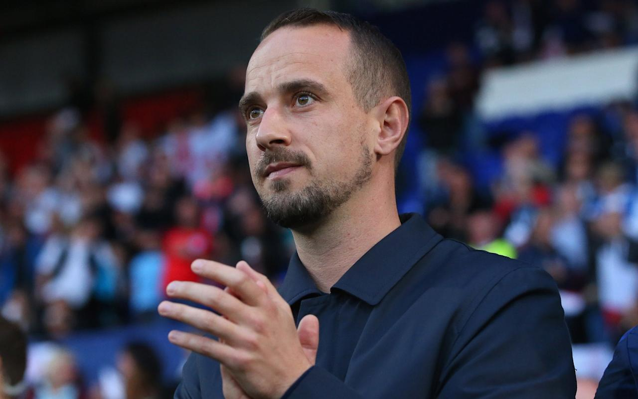 "The Football Association came under severe criticism on Wednesday for missing the detail of a 2014 report into the conduct of England Women manager Mark Sampson, who was finally sacked for ""overstepping the professional boundaries between player and coach"". FA chief executive Martin Glenn called Sampson to Wembley the morning after his team's 6-0 World Cup qualifying win over Russia to tell him his conduct while in his previous job at Bristol Academy was ""was not what we want from an FA employee"". The minister for sport, Tracey Crouch, branded the situation a ""mess"". She added that ""it raises very serious questions about whether the historic processes that the FA had in place around the recruitment of coaches were appropriate, for something like this to have been missed. The FA is right to have taken action but reassurance is needed to make sure this does not happen again at any level of coaching"". In a statement on Sampson's sacking, the FA said the ""safeguarding assessment was that he did not pose a risk working in the game"". The statement continued: ""It is our judgement that it [the safeguarding report] revealed clear evidence of inappropriate and unacceptable behaviour by a coach. It is on this basis that we have acted quickly to agree a termination of Mark's contract. Speaking at a briefing at Wembley, Glenn said: ""Why has he gone? It's about Mark's conduct during his time at Bristol. We believe he breached his professional boundaries."" We can confirm that Mark Sampson has left his position as head coach of the @England Women's team. Full statement: https://t.co/iNL1lSW74j— The FA (@FA) September 20, 2017 The FA refused to disclose the details of Sampson's misconduct but later made clear it was about ""boundaries between coach and players"". Glenn described the case as ""the most awkward and complicated issue I have ever dealt with"". He said: ""We know that coaches are in a potential position of power and that position mustn't be abused. That's been true across all sports and is true in football as well. We have to be really clear and I think we are at the FA about what we stand for in that respect. He is not deemed a safeguarding risk in football but to us it's a conduct issue. The standards we set in the FA would not be compatible. A club [considering employing Sampson] would have to make their own mind up."" Sampson, 34, was sacked amid allegations of racial discrimination by former England international Eniola Aluko against him. He was previously cleared of any wrongdoing in that regard by an independent FA investigation by the barrister Katharine Newton. That investigation, separate to his dismissal, is poised to be re-opened in the light of Aluko's Chelsea team-mate, Drew Spence, coming forward to corroborate her claims. Eni Aluko made the initial allegations against Sampson Credit: Getty images The original concerns about Sampson's behaviour during his time at what is now Bristol City Women's Football Club were passed on anonymously to the FA in March 2014, four months after he took the England manager's job. The FA confirmed on Wednesday it had conducted a safeguarding investigation into Sampson which concluded in March 2015 that, in the FA's words, ""he did not pose a risk working in the game"". Sampson's first job at Bristol in 2009 was at the centre of excellence and he moved up the age groups to coach the first team from 2011 before he moved to the FA in December 2013. It was not until October 2015 that Glenn learned of the existence of the FA's safeguarding investigation into Sampson when he was told that the coach had completed a ""development and mentoring programme"" recommended by the probe. Glenn said that it was common practice for the safeguarding investigation team at the FA to present their evidence confidentially to a panel who then gave a simple ruling on whether or not the individual was cleared to work in football. Glenn said it was a source of regret that he did not request to see the details and that the ""bureaucratic mindset"" of the FA at that time dictated that no-one thought to flag up wider concerns. Tracey Crouch described the situation as 'a mess' Credit: Getty images With the Aluko case generating public scrutiny, the FA was again contacted by outside sources last week who suggested it should revisit the Sampson investigation. The head of the legal and human resources departments recommended Glenn have full sight of the report and having read it last Wednesday, he and the FA chairman Greg Clarke both told the FA board that Sampson should be sacked. That decision was approved by the board unanimously on Monday. Glenn said: ""No law was broken … we felt during his time at Bristol, Mark had overstepped the professional boundaries between player and coach. When I first read the report I absorbed it and took Greg through it and we both agreed that Mark's position was untenable and we shared it with the board over the weekend."" The England coach was unaware the report had been revisited until Wednesday morning following his side's victory at Prenton Park the previous night. Sampson took England to third place at the World Cup finals in Canada in July 2015, their best-ever performance at that tournament. He had a contract until 2019. Glenn said the coach was ""upset"" when told of his sacking over the phone. England's players celebrate with Mark Sampson after Nikita Parris's opening goal during the Fifa Women's World Cup Qualifier between England and Russia on Tuesday Credit: Alex Livesey/Getty Images The FA said there were no concerns about Sampson being in charge on Tuesday night because it was not a safeguarding issue. The delay until Wednesday was because those who had been interviewed in the original investigation had to be contacted before the decision was made public. Glenn said that it was ""technically"" Sir Trevor Brooking who ""was the guy in charge at St George's Park at the time, on the hiring panel"" when Sampson was appointed. Glenn said: ""We are not going to apologise for wanting to drive higher standards. Let's look at safeguarding in sport and football, the whole culture has been ignore it, don't deal with it, hide it, put it under the carpet because bad things will happen. We know we can't do that. There are plenty of people in the game who have got an unblemished record to provide a great pool for us to continue to recruit great coaches from. I am not worried about us having high standards and putting people off."" Sampson was dropped as a patron for the charity Women in Sport late on Wednesday. A statement on its website read: ""Following today's announcement by the Football Association, Women in Sport can confirm that Mark Sampson is no longer a Patron of the Charity. ""The Charity hopes that media attention will now return to the women's football team performance on the pitch, and that women and girls up and down the country will continue to be inspired by the Lionesses' World Cup campaign."" The women's team play their next game, a friendly against France in Valenciennes on Oct 20, and the FA is yet to appoint a successor to Sampson. The main players in the Mark Sampson scandal 