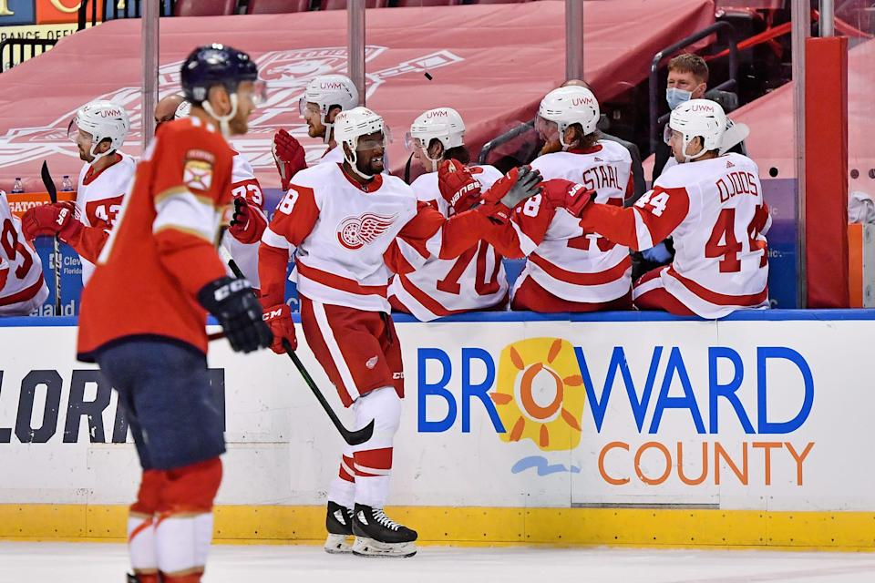 Feb 7, 2021; Sunrise, Florida, USA; Detroit Red Wings left wing Givani Smith (48) celebrates his goal against the Florida Panthers with teammates on the bench during the second period at BB&T Center.
