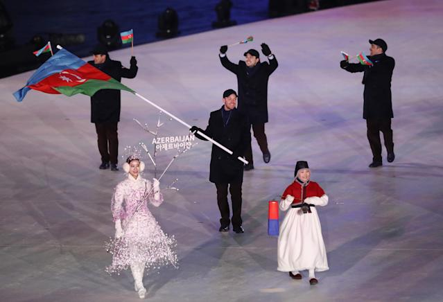 <p>Flag bearer Patrick Brachner of Azerbaijan leads the team during the Opening Ceremony of the PyeongChang 2018 Winter Olympic Games at PyeongChang Olympic Stadium on February 9, 2018 in Pyeongchang-gun, South Korea. (Photo by Ronald Martinez/Getty Images) </p>