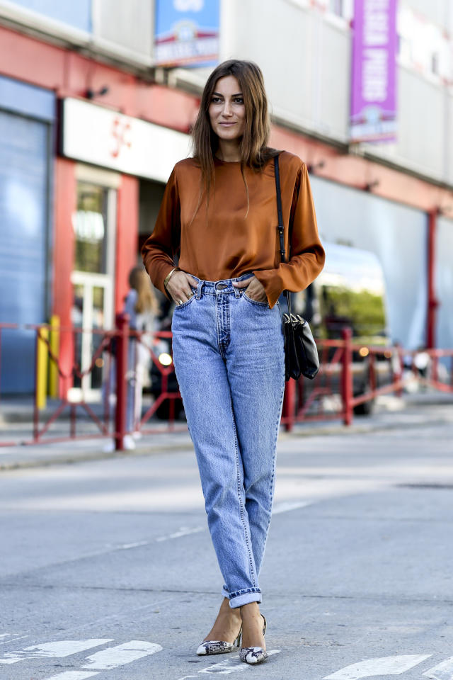 Blue denimis inherently casual, so to make it feel a little more dressy and grown-up, tuck in a silky, long-sleeve blouse and then add tonal pumps.