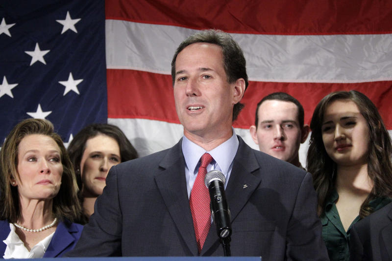 Surrounded by his family, former Pennsylvania Sen. Rick Santorum announces he is suspending his candidacy for the presidency effective today, Tuesday, April 10, 2012, in Gettysburg, Pa. (AP Photo/Gene J. Puskar)