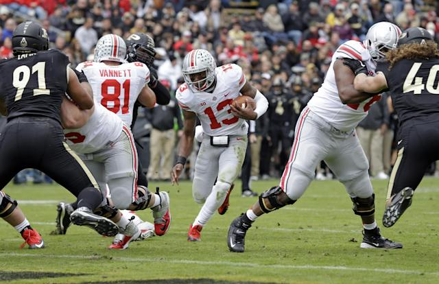 Ohio State quarterback Kenny Guiton cuts between blocks on his way to a touchdown during the second half of an NCAA college football game in West Lafayette, Ind., Saturday, Nov. 2, 2013. Ohio State defeated Purdue 56-0. (AP Photo/Michael Conroy)