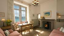 """<p>Never did we think we'd want to head back to school but this converted Victorian school house makes us quite tempted. Below the 1876 property's walled garden is the Helford River with views stretching across the beach. </p><p>Open your curtains in the morning and look out on to the waves before taking your morning cuppa onto the shore-front and head out onto the South West Coast Path, which runs directly through the village.</p><p><strong>House for four people from £384</strong></p><p><a class=""""link rapid-noclick-resp"""" href=""""https://go.redirectingat.com?id=127X1599956&url=https%3A%2F%2Fwww.nationaltrust.org.uk%2Fholidays%2Fthe-old-school-house-durgan-cornwall&sref=https%3A%2F%2Fwww.elle.com%2Fuk%2Flife-and-culture%2Fculture%2Fg33261665%2Fcoastal-cottages%2F"""" rel=""""nofollow noopener"""" target=""""_blank"""" data-ylk=""""slk:BOOK ONLINE"""">BOOK ONLINE</a></p>"""