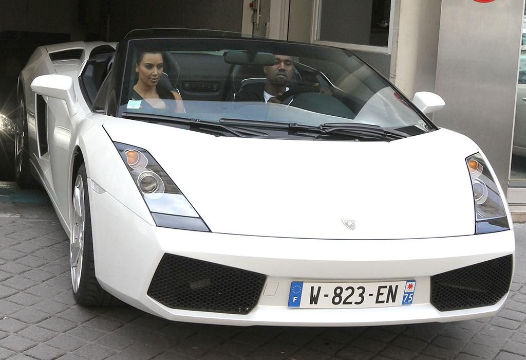 "<strong>Kim Kardashian and Kanye West </strong><br /><strong>Lamborghini </strong><br /><strong>Approximate Base Price: $750,000</strong><br />OK, so the particular Lamborghini pictued here that the happy couple tooled around in while visiting Paris last summer was only a rental, but you know they're passionate about fast cars when they can't make it a few days without splurging on renting a substitute Lamorghini while out of town for a few days. West's real <a href=""http://autos.yahoo.com/lamborghini/gallardo/"" target=""_blank"">Lamborghini</a> was reportedly <a href=""http://omg.yahoo.com/news/pic-kim-kardashian-buys-kanye-west-750-000-000000661.html"" target=""_blank"">a gift Kim gave him last June </a>for his 35th birthday, and is worth an estimated $750K. Kardashian, whose auto obsession has been documented on her show ""Keeping Up With Kardashians,"" has been known to drive a Ferrari 458 Italia valued at more than $229,825. But how are they going to fit a car seat in those things?"