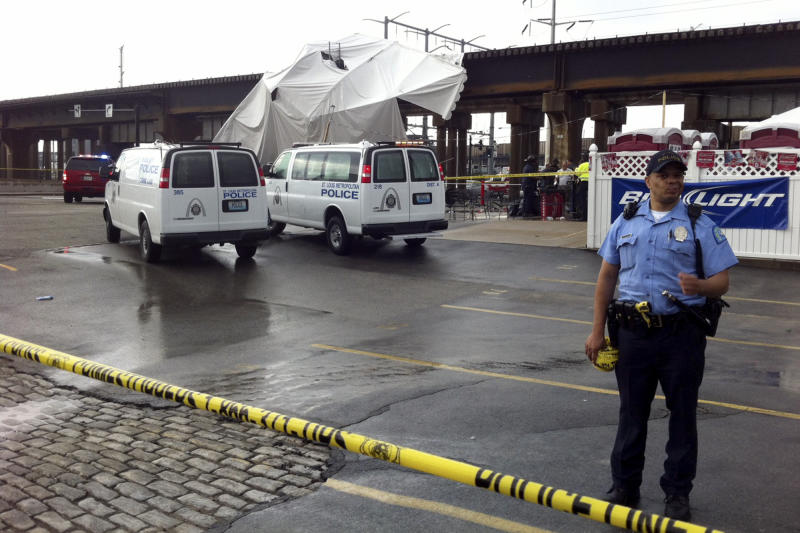 Officials respond to the scene where a tent blew over after high winds crossed the area, Saturday, April 28, 2012, in St. Louis. The tent was set up next to Kilroy's Sports Bar, where St. Louis Fire Chief Dennis Jenkerson said a few hundred people were celebrating after the St. Louis Cardinals defeated the Milwaukee Brewers 7-3 in a baseball game. Emergency officials said 16 people were taken to hospitals with injuries ranging from minor to very serious. KSDK reported that fire officials said five people were in critical condition and 100 people were treated at the scene. (AP Photo/St. Louis Post-Dispatch, Emily Rasinski)  EDWARDSVILLE INTELLIGENCER OUT; THE ALTON TELEGRAPH OUT