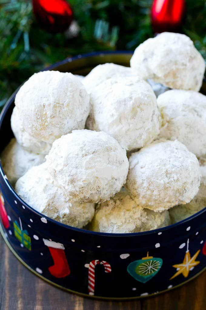 """<p>Aptly named cookies studded with pecans and chocolate chips, then rolled in plenty of powdered sugar. </p><p><a href=""""https://www.dinneratthezoo.com/snowball-cookies/"""" rel=""""nofollow noopener"""" target=""""_blank"""" data-ylk=""""slk:Get the recipe"""" class=""""link rapid-noclick-resp"""">Get the recipe</a>.</p>"""