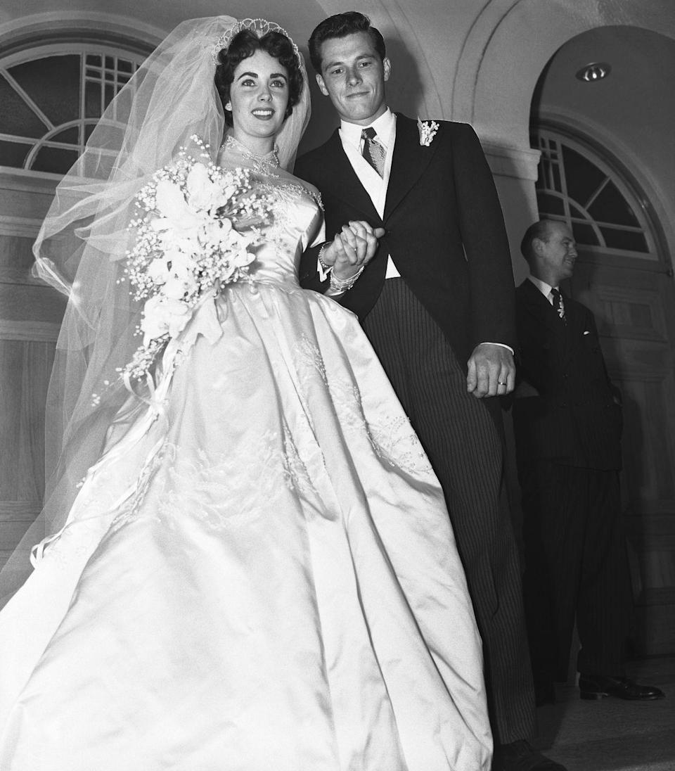 <p>American hotelier Conrad Hilton's son Nicky Hilton married Elizabeth Taylor when she was just 18 in a ceremony in Beverly Hills. </p><p>MGM organized the fabulous event, and Elizabeth's dress was designed by famed costume maker Helen Rose. Her team of 15 people took an entire <em>three</em> months to create the gown out of satin and seed pearls, and the train is a whopping 15 yards. FYI, the couple divorced just eight months later.</p>