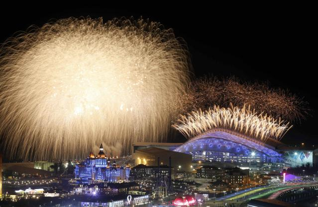 Fireworks are seen over the Olympic Park during the opening ceremony of the Sochi 2014 Winter Olympics, February 7, 2014. REUTERS/Alexander Demianchuk (RUSSIA - Tags: SPORT OLYMPICS TPX IMAGES OF THE DAY)