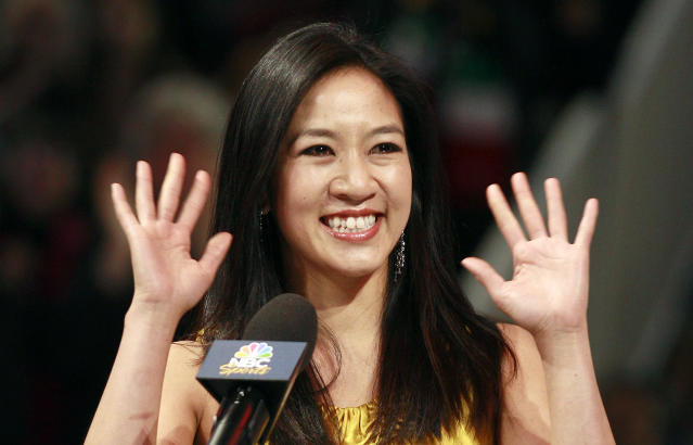 <p>Former figure skater Michelle Kwan waves at an on-ice recognition for her Hall of Fame induction at the U.S. Figure Skating Championships in San Jose, Calif., Saturday, Jan. 28, 2012. (AP Photo/Jeff Chiu) </p>