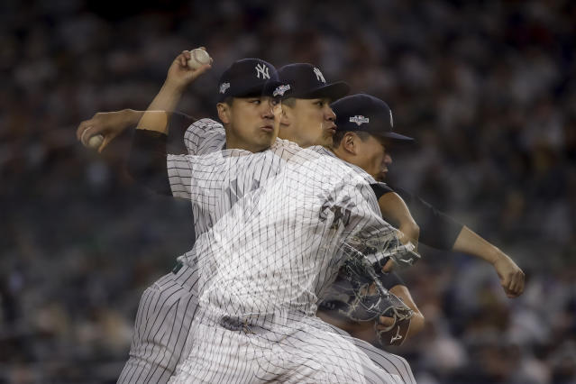 In this multiple exposure image, New York Yankees starting pitcher Masahiro Tanaka delivers against the Minnesota Twins during the fifth inning of Game 2 of an American League Division Series baseball game, Saturday, Oct. 5, 2019, in New York. (AP Photo/Frank Franklin II)