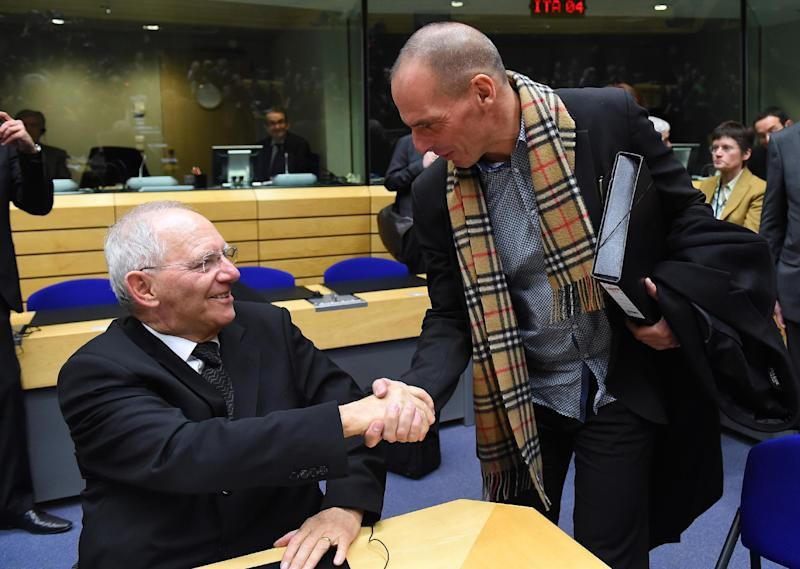 Greek Finance Minister Yanis Varoufakis (R) shakes hands with German Finance Minister Wolfgang Schauble during an emergency Eurogroup finance ministers meeting at the European Council in Brussels on February 11, 2015